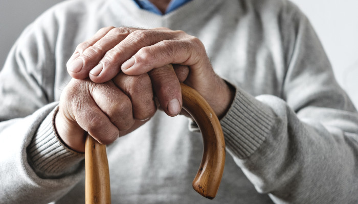 A senior ages in place successfully, with the help of a caregiver
