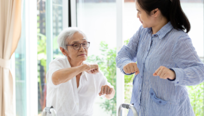 A senior companion helps an elderly adult build healthy habits